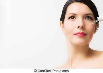 topless, mulher jovem, segurando, um, líquido, distribuidor
