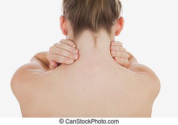 Topless woman massaging her neck