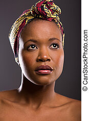 topless young african woman wearing headscarf