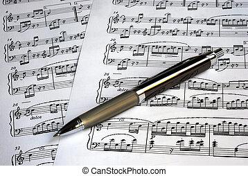 topo, música, caneta, folhas