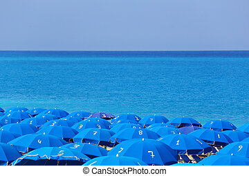 Tops of blue parasols and sea Kathisma Lefkada Greece