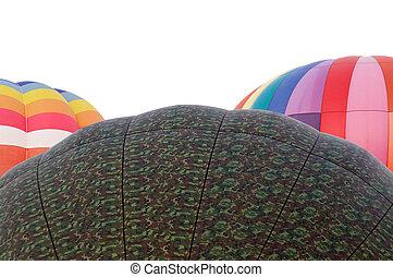 tops of three hot air balloons