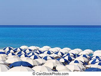 Tops of white and blue parasols Kathisma Lefkada Greece
