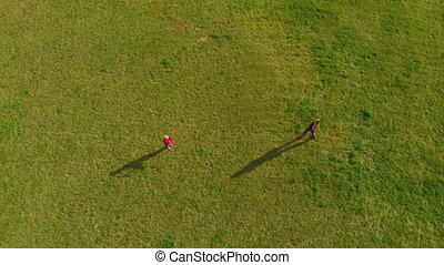 Topview Aerial shot of a yound woman and her little son...