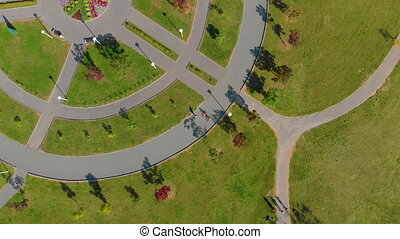 Topview Aerial shot of two little boys riding bicycles in a...
