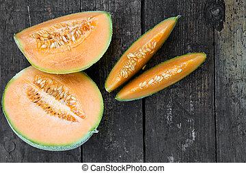 topview of some sliced cantaloupe melon pieces