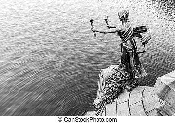 Torch bearer woman figure - bronze decoration of Svatopluk Cech Bridge over Vltava River in Prague, Czech Republic