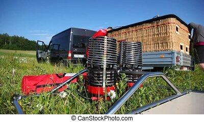 Torch lies on green grass near basket after flight