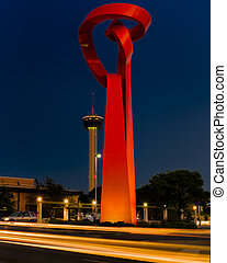 Large red abstract sculpture near the Riverwalk in San Antonio, TX