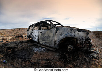 Torched Vehicle - An abandoned and torched SUV in the desert...