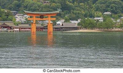 Tori gate at sea on Miyajima, Hiroshima - Approatching...