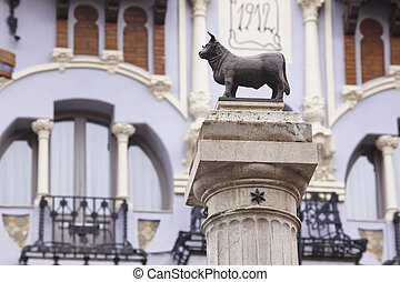 Torico bull sculpture and modernism facade in Teruel. Spain