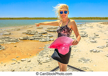 Torist Woman at Stromatolites - Happy woman pointing at ...