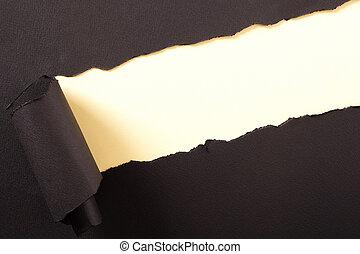 Torn black paper strip yellow background diagonal angle