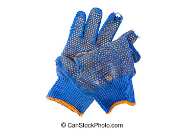 torn blue gloves for working in the ground
