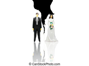 plactic wedding couple figures on ripped paper - (divorce concept)