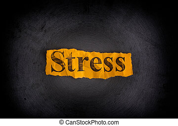 Torn crumpled piece of paper with the word Stress