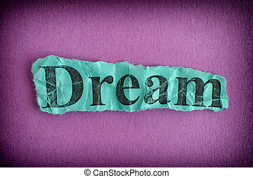 Torn crumpled piece of paper with the word Dream