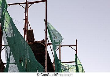 torn debris netting scaffold