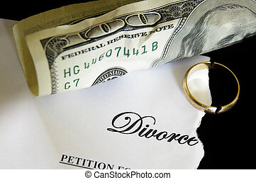 torn divorce decree and cash, with broken wedding ring