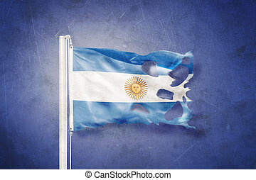 Torn flag of Argentina flying against grunge background
