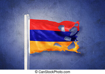 Torn flag of Armenia flying against grunge background