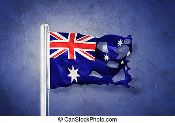 Torn flag of Australia flying against grunge background