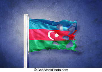 Torn flag of Azerbaijan flying against grunge background