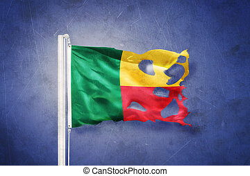 Torn flag of Benin flying against grunge background
