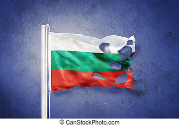 Torn flag of Bulgaria flying against grunge background