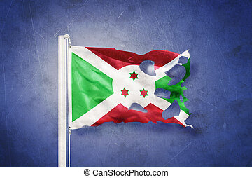 Torn flag of Burundi flying against grunge background