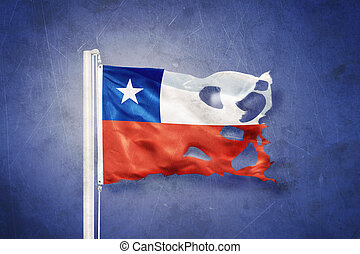 Torn flag of Chile flying against grunge background