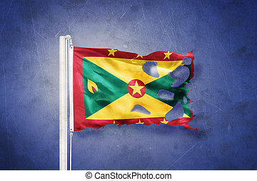 Torn flag of Grenada flying against grunge background