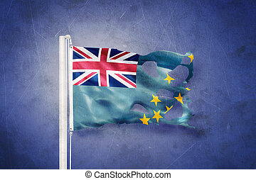 Torn flag of Tuvalu flying against grunge background