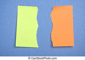 Torn green and orange postits. - Post it notes torn. Concept...