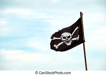 Torn Jolly Roger flies from flagpole - Ragged pirate flag...