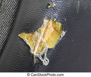 Torn leather seat