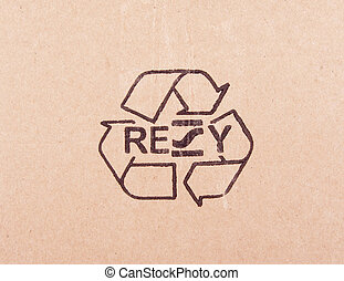 torn out piece of cardboard with recycle symbol