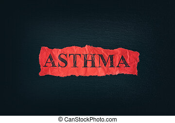 Torn piece of paper with the word Asthma