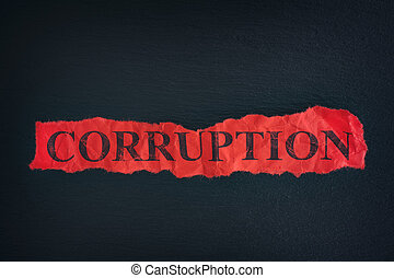 Torn piece of paper with the word Corruption