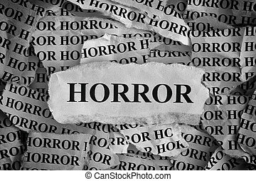 Torn pieces of paper with the word «Horror»