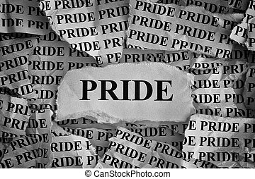 Torn pieces of paper with the word Pride