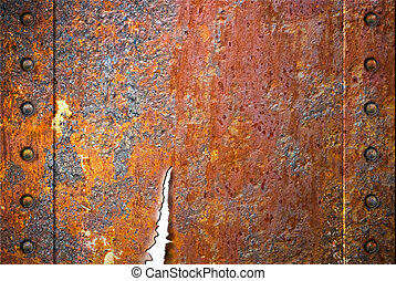 Torn rusty metal texture with rivets over red background