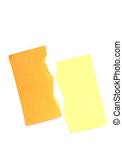 Post it notes. Orange and yellow. Torn in half.