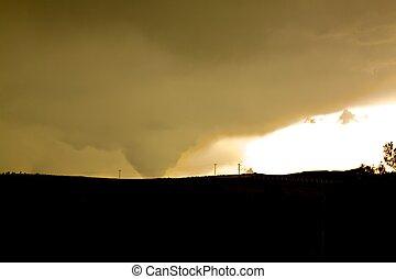 Tornado - a wedge shaped tornado over the prairie