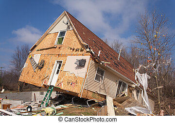 LAPEER COUNTY, MI - MARCH 16: A home heavily damaged by an F2 tornado that swept through Oregon Twp in Lapeer County, MI on March 15, 2012. The house was lifted from its foundation.