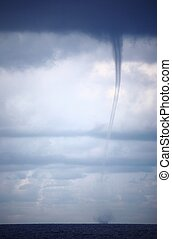 Tornado and storm clouds in the Indian Ocean