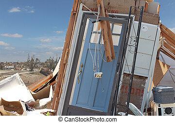 Tornado Damage Blue Front Door - A damaged blue front door...