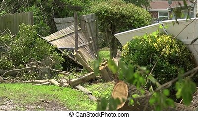 tornado damaged fence - A fence that was damaged by a...