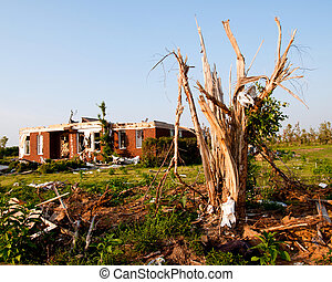 Tornado-damaged land and home in northern Alabama one month after storm.